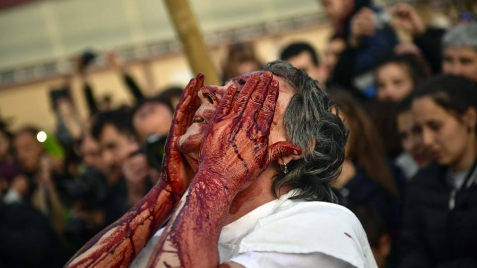 "A costumed ""momotxorro"" covers his face with blood while taking part in a carnival in Alsasua, northern Spain. Dozens of devil-like figures danced and convulsed at the sound of cowbells, chasing onlookers with pitchforks in Alsasua as part of this northern Spanish town's Carnival. (Alvaro Barrientos / AP)"