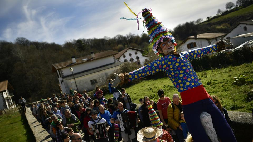People carry a giant Miel Otxin, the symbol of the carnival, in the Pyrenees village of Lantz. Such festivities were banned during the 1939-1975 dictatorship of Gen. Francisco Franco in Spain, but have been revived since the early 1990s. (Alvaro Barrientos / AP)