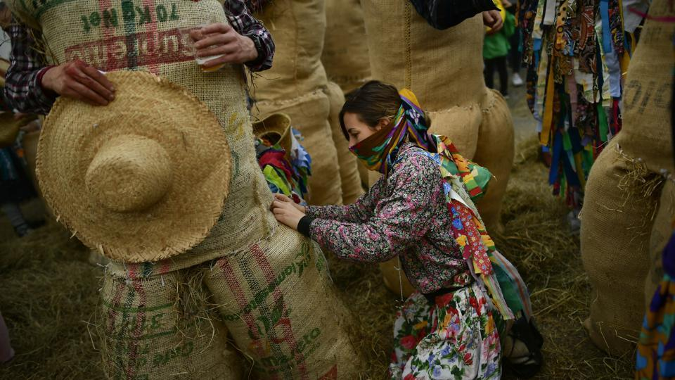"In the nearby village of Lesaka, residents dress up as the traditional Carnival characters ""Zaku Zaharrak,"" meaning ""old sack"" in the local Basque language. (Alvaro Barrientos / AP)"