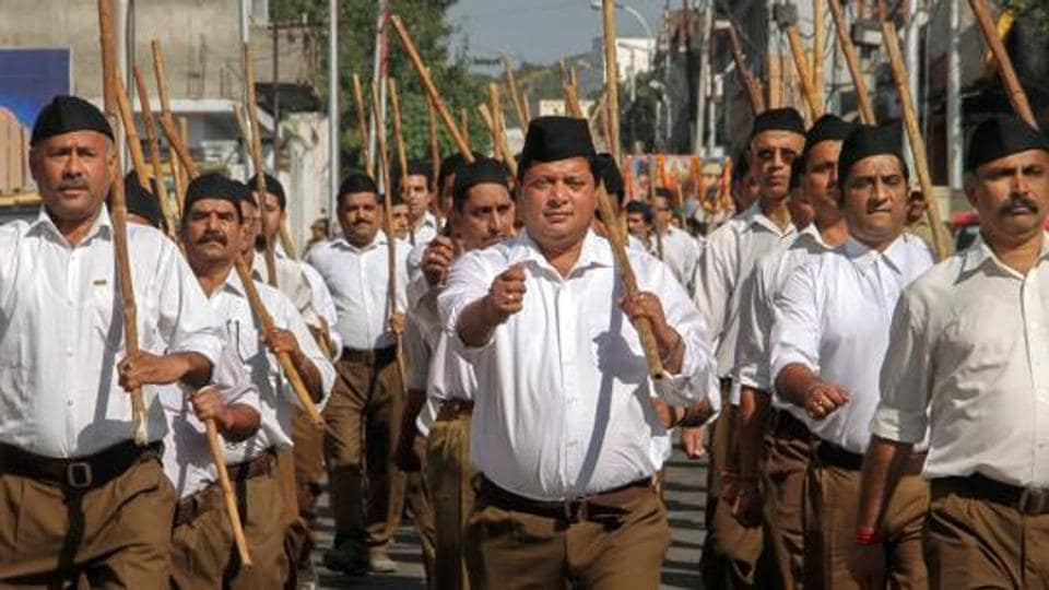 RSS workers participate in a foot march in Jammu.