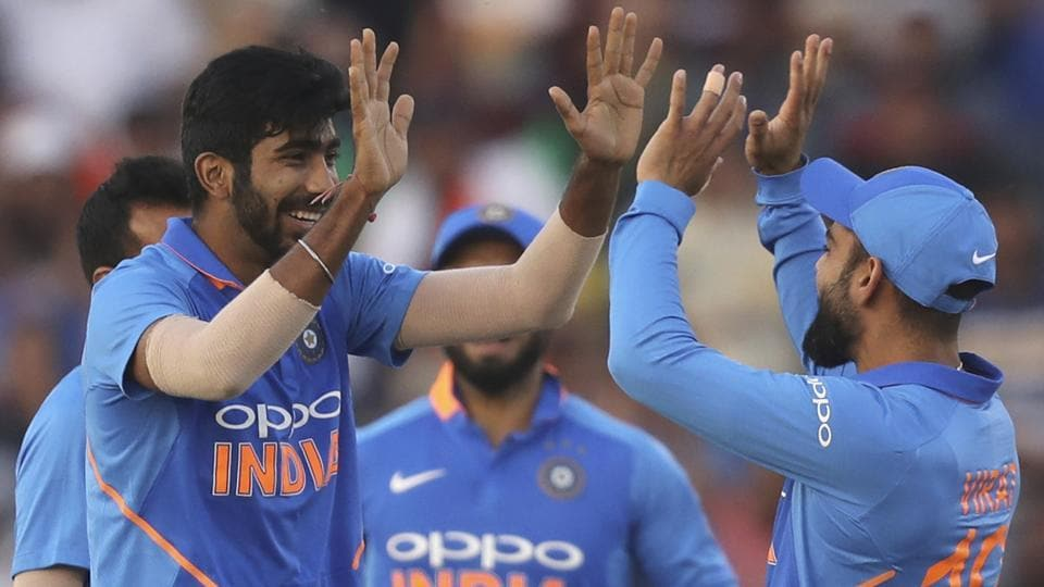 Virat Kohli, right, and Jasprit Bumrah celebrate the dismissal of Australia's Shaun Marsh.