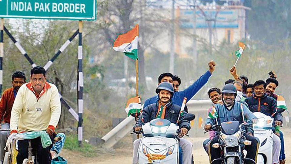 People celebrate IAF pilot Abhinandan Varthaman's release by Pakistan authorities, at the Attari-Wagah border near Amritsar. Several commentators believe that air strikes on a Pakistani terror base have given the BJP a decisive edge over its opponents, with debates on national security taking centre stage.