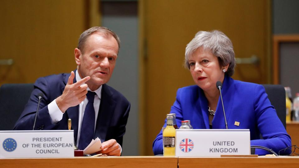 British Prime Minister Theresa May (R) and European Union Council President Donald Tusk during the extraordinary EU leaders summit to finalise and formalise the Brexit agreement in Brussels, Belgium.