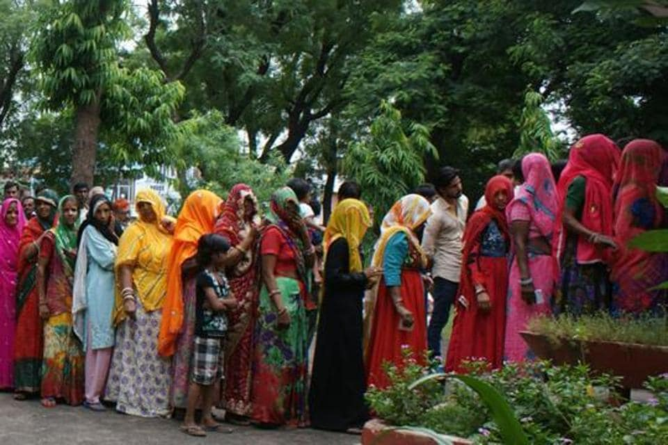 Rajasthan, India – August 17, 2015: Women voters wait to cast their votes during Municipal Corporation polls at a polling booth of Chomu, in Jaipur, Rajasthan, India on Monday, August 17, 2015.
