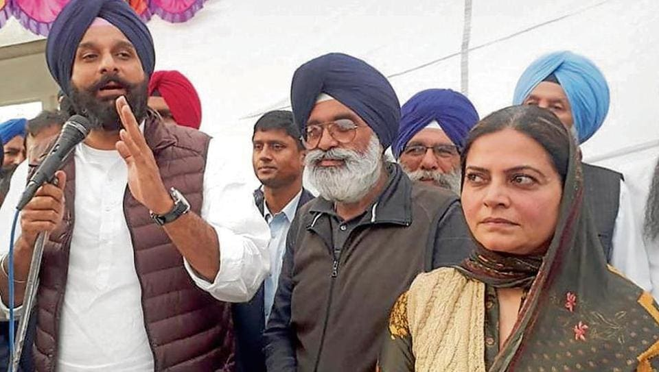 Former Punjab minister and leader Bikram Singh Majithia (L) addressing a public meeting organised to induct Gurinder Singh Tony (C) into Shiromani Akali Dal (SAD) in Tarn Taran on Wednesday.