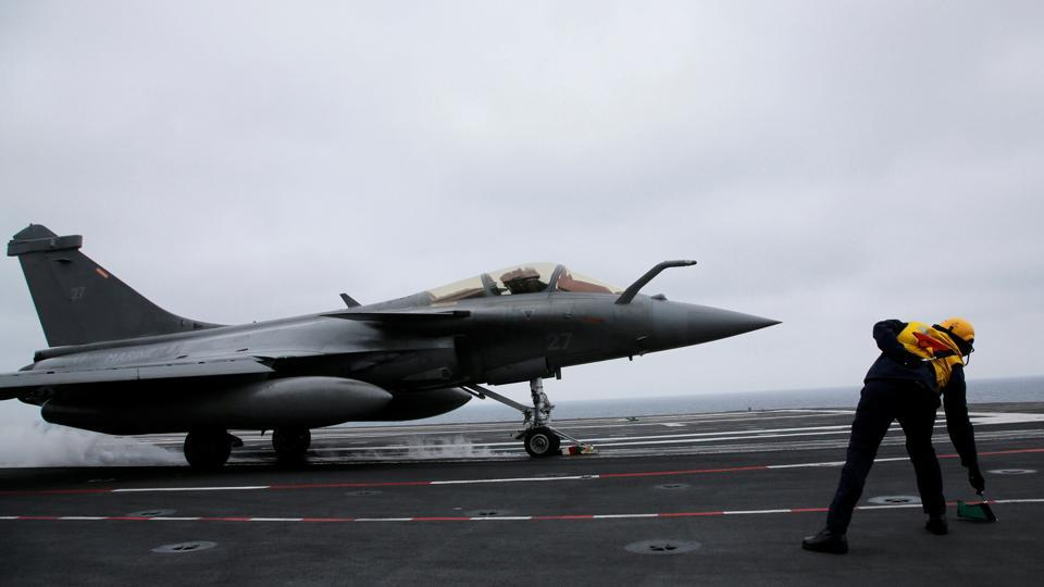 A French Rafale fighter jet prepares to take off from the French aircraft carrier Charles de Gaulle in the Mediterranean sea.