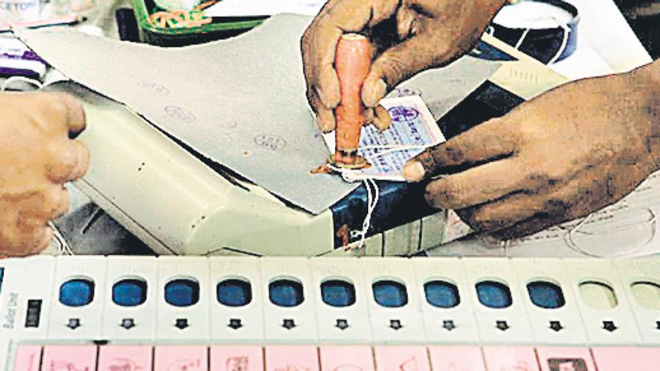 Election Commission staff sealing the EVMS after an election.