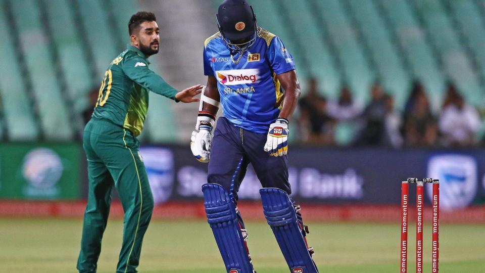 Tabraiz Shamsi of South Africa (L) and Thisara Perera of Sri Lanka react during the third one-day international (ODI) cricket match between South Africa and Sri Lanka at Kingsmead Cricket Stadium in Durban on March 10, 2019
