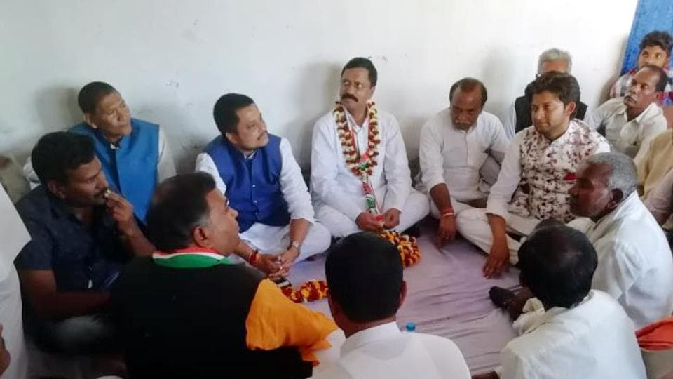 Former state director general of police Rajeev Kumar ( in garland) holds meeting with Congress workers in Daltonganj India, on Wednesday