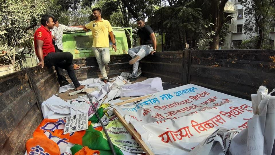 As model code of conduct comes in picture since the election are declared, Pune Municipal Corporation team get into action in removing posters and banners of different political parties across the city. (RAHUL RAUT/HT PHOTO)