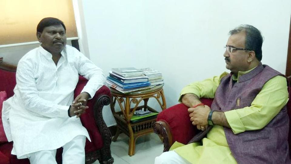 BJP's Jharkhand Lok Sabha election in-charge Mangal Pandey (right) meeting with former Chief minister Arjun Munda at his Munda's residence in Ranchi