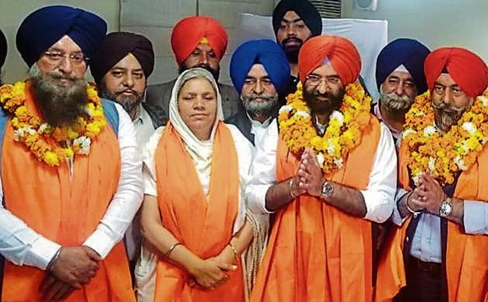 Newly elected DSGMC vice-president Kulwant Singh Baath, senior vice-president Ranjit Kaur, president Manjinder Singh Sirsa and general secretary Harmeet Singh Kalka after their victory.