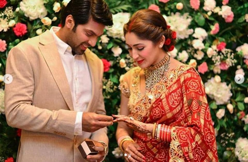 Sayyeshaa and Arya pose for the shutterbugs at their wedding reception in Chennai, four days after they tied the knot in Hyderabad.