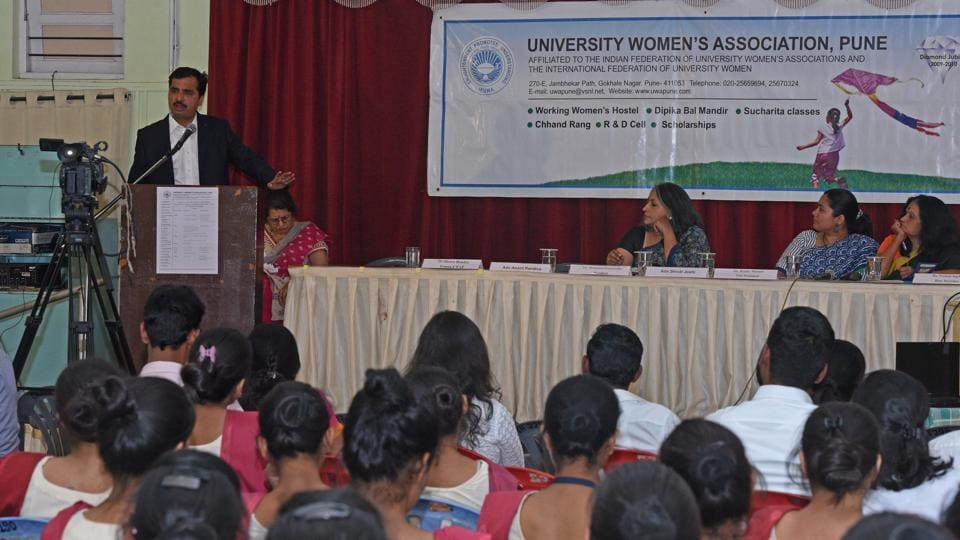 Advocate Anant Randive interacts with people during seminar on sexual harassment of women at work at University Women's Association, Patrakarnagar.
