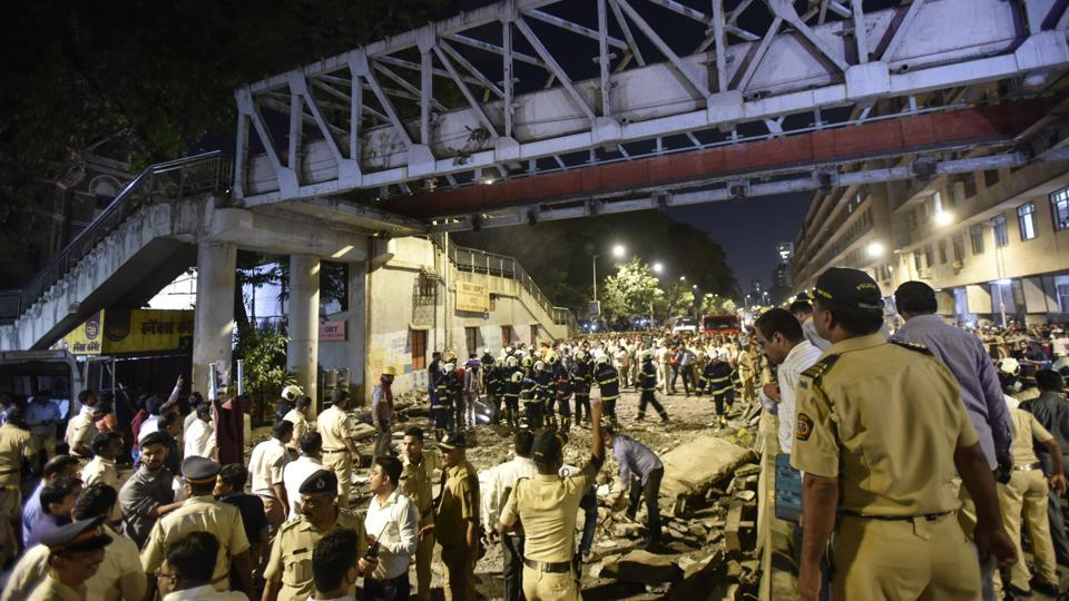 "Maharashtra Chief Minister Devendra Fadnavis has set a Friday evening deadline for the authorities to find what led to collapse of a foot-over bridge in Mumbai yesterday. Six people lost their lives in the incident. Many others were injured. Fadnavis, who visited the site said he has asked the authorities to ""fix primary responsibility"" for the bridge collapse by ""this evening"". (Kunal Patil / HT Photo)"