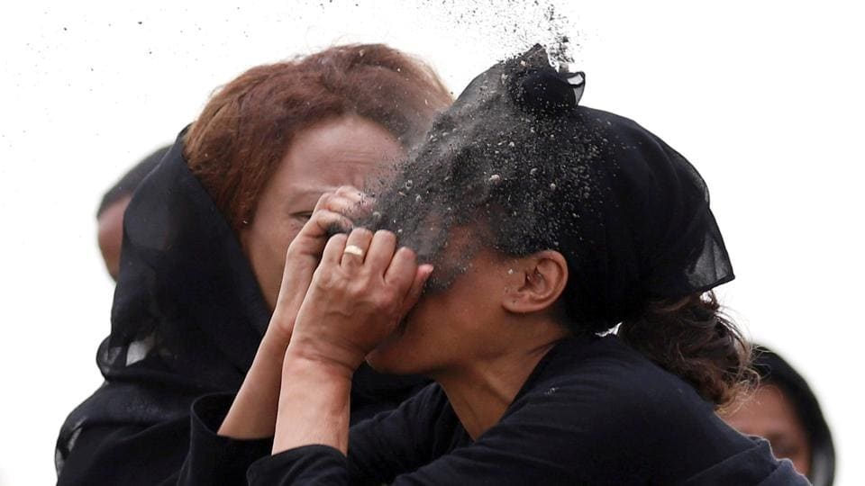 A relative puts soil on her face as she mourns at the scene of the Ethiopian Airlines Flight ET 302 plane crash, near the town Bishoftu, near Addis Ababa, Ethiopia. (Tiksa Negeri / REUTERS)