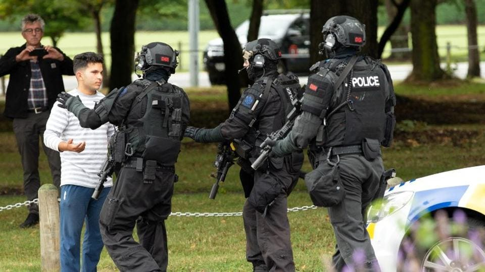 AOS (Armed Offenders Squad) push back members of the public following a shooting at the Masjid Al Noor mosque in Christchurch, New Zealand.