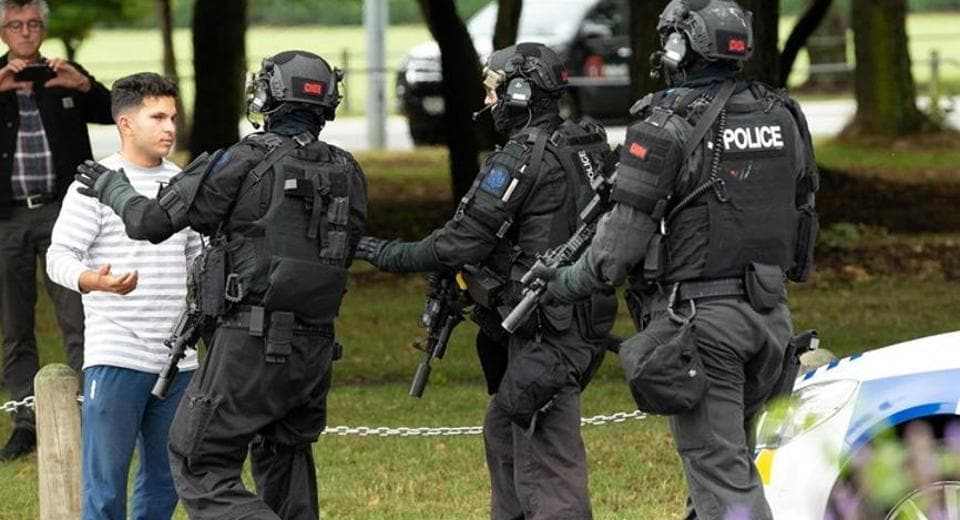 New Zealand was placed on its highest security threat level, Ardern said, adding that four people taken into custody held extremist views but had not been on any police watchlists.