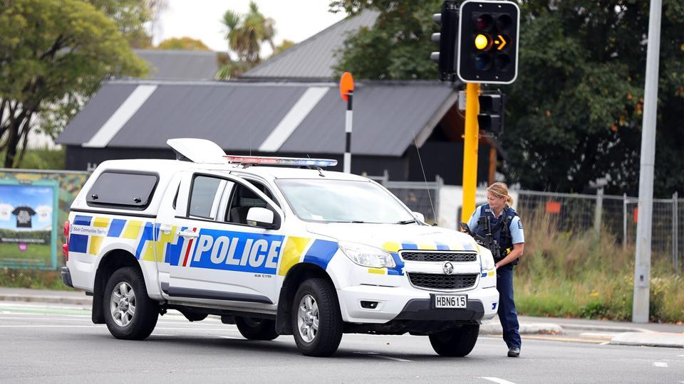 This picture released by Radio New Zealand shows a police officer cordoning a street near the mosque after a firing incident in Christchurch on March 15, 2019.