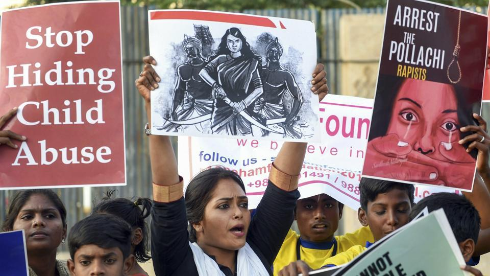 Members of various Tamil organisations hold placards and raise slogans during a protest against the Pollachi sex scandal in Chennai, Friday.