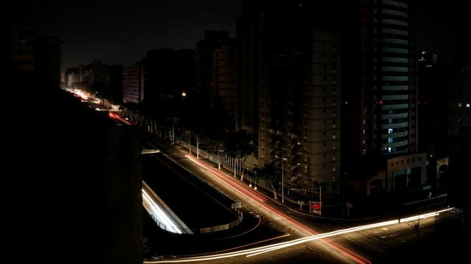 Car lights are seen on one of the main roads of the city during the second day of a blackout in Caracas, Venezuela. (Carlos Jasso / REUTERS)