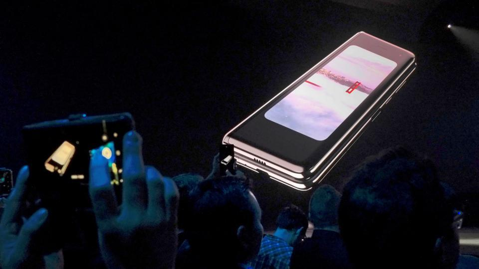 The Samsung Galaxy Fold phone is shown on a screen at Samsung Electronics Co Ltd's Unpacked event in San Francisco, California, U.S., February 20, 2019.