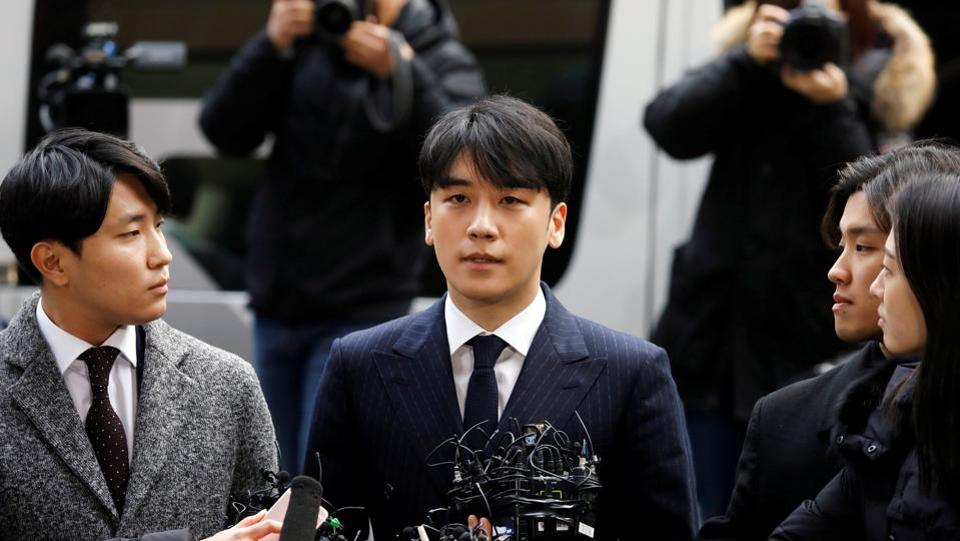 Seungri, a member of South Korean K-pop band Big Bang, arrives to be questioned over a sex bribery case at the Seoul Metropolitan Police Agency in Seoul, South Korea. (Kim Hong-Ji / REUTERS)