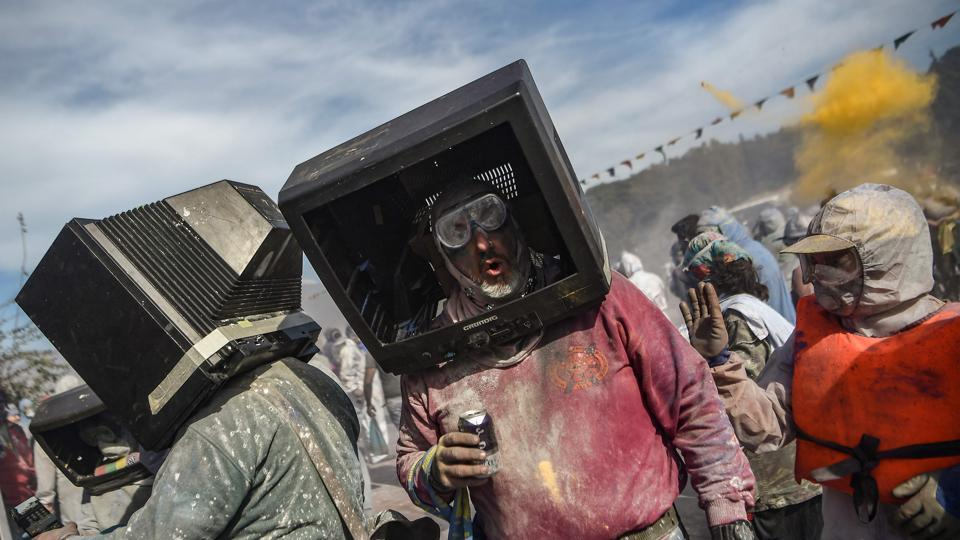 Revellers use old TVs as masks as they participate in a colourful 'flour war' during 'Ash Monday' celebrations, in the port town of Galaxidi, Greece. (Aris Messinis / AFP)