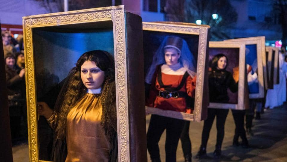 Costumed revelers perform in a carnival procession on the streets of Strumica, Macedonia, during the great evening carnival which marks the beginning of the Christian Orthodox Lent. (Robert Atanasovski / AFP)