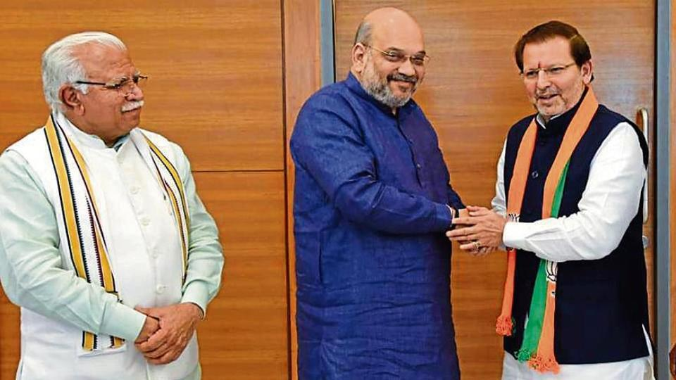 Former MPArvind Sharma (right)with BJPnational president Amit Shah and Haryana chief minister Manohar Lal Khattar in New Delhi on Friday