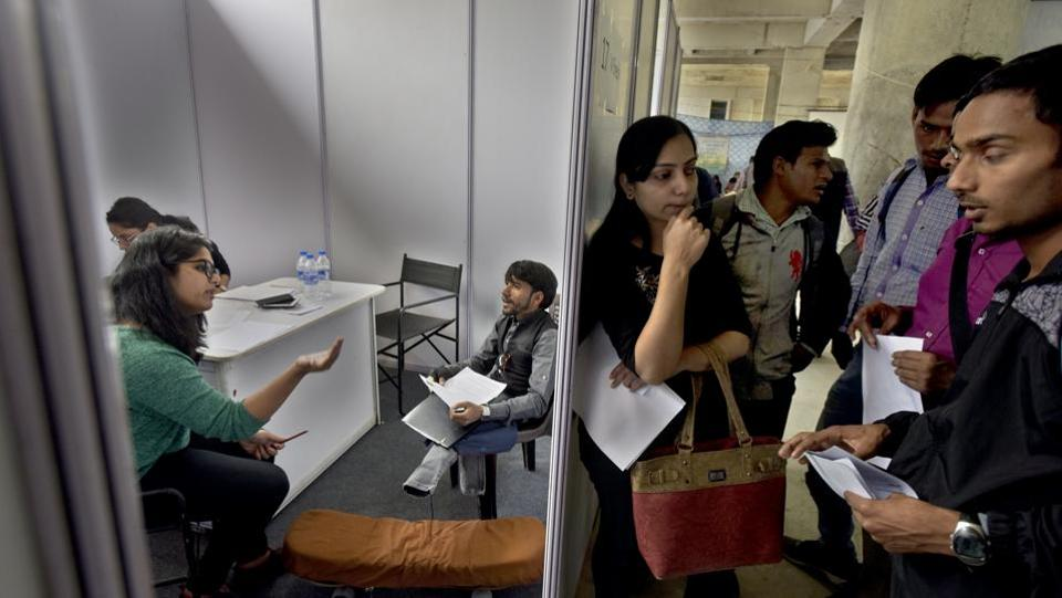 Specially-abled candidates wait for their interview during a Job Fair by Blind Relief Association at Lal Bahadur Shashtri Marg, in New Delhi. (Sushil Kumar / HT Photo)