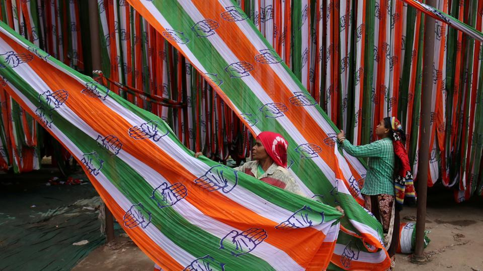 A worker pulls a roll of flags of India's main opposition Congress party kept for drying at a flag manufacturing factory, ahead of the 2019 general elections, in Ahmedabad, Gujarat. (Amit Dave / REUTERS)
