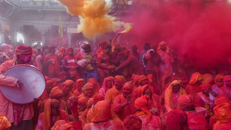 People play gulal or coloured powders during 'Laddu Holi' at Radha Rani Temple in Barsana of Mathura district, Uttar Pradesh. (Kamal Kishore / PTI)