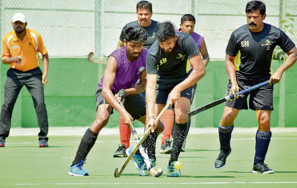 PRahul Rasal (purple) of Rovers Academy in action against Super XI in the pre-quater finals of the first edition of the hockey friendship cup invitational tournament played at Major Dhyanchand Hockey Stadium in Pimpri on Sunday.