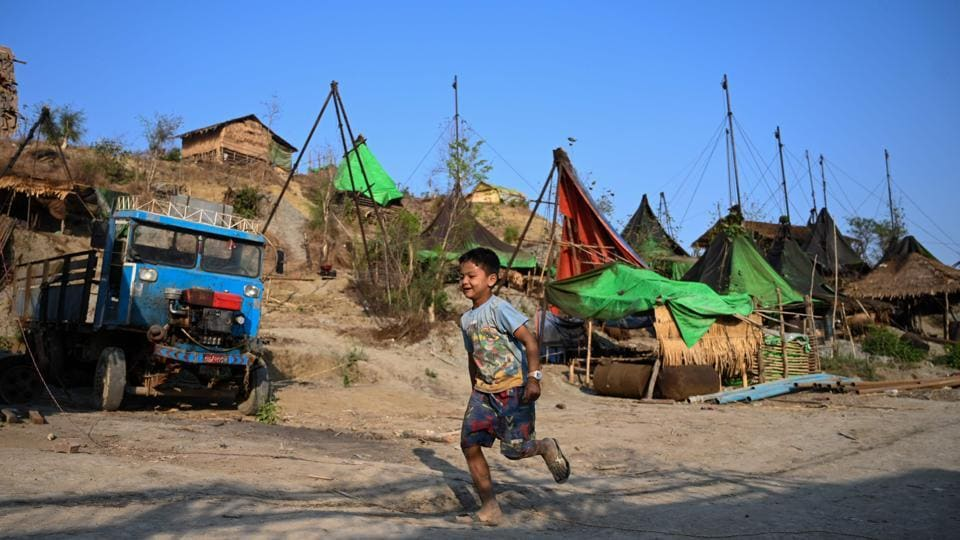 Many even bring their families along for their nomadic life. Children run around the hillsides dodging motorbikes and trucks transporting barrels of oil, while a handful of restaurants and tea shops serve the transient population of several thousand. (Ye Aung Thu / AFP)