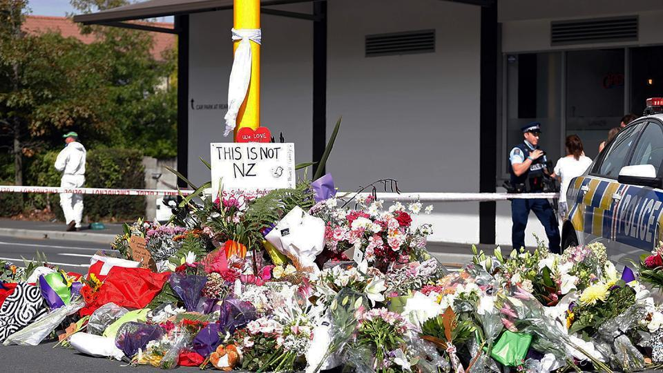 Residents pay respect by placing flowers for the victims of the mosques attacks in Christchurch on March 16, 2019.