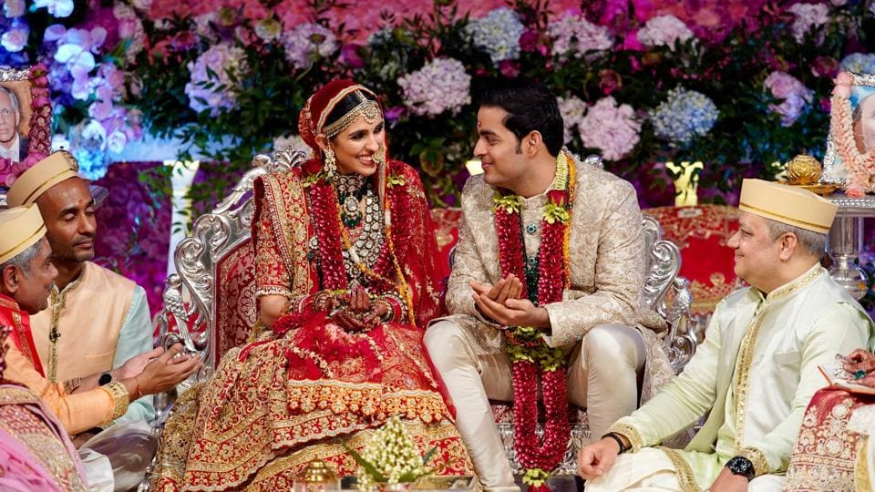 Akash Ambani, son of Mukesh Ambani, Chairman of Reliance Industries, and Shloka Mehta perform a ritual during their wedding ceremony at Bandra-Kurla Complex in Mumbai, Maharashtra. (Reliance Industries / Handout via REUTERS)