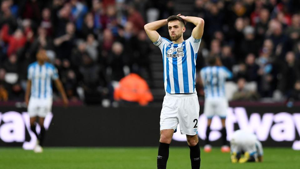 Huddersfield Town's Tommy Smith reacts after losing to West Ham.