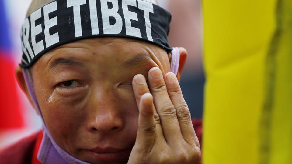 A Tibetan nun cries as she attends a protest held to mark the 60th anniversary of the Tibetan uprising against Chinese rule, in New Delhi. (Adnan Abidi / REUTERS)