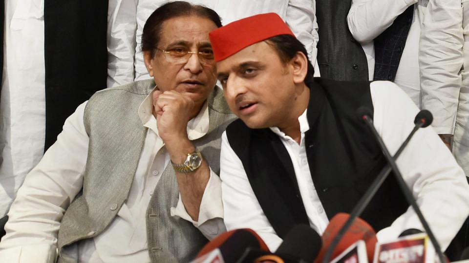 Samajwadi Party president Akhilesh Yadav and senior leader Azam Khan address a press conference after the by-election results, at the party headquarters in Lucknow on Wednesday.