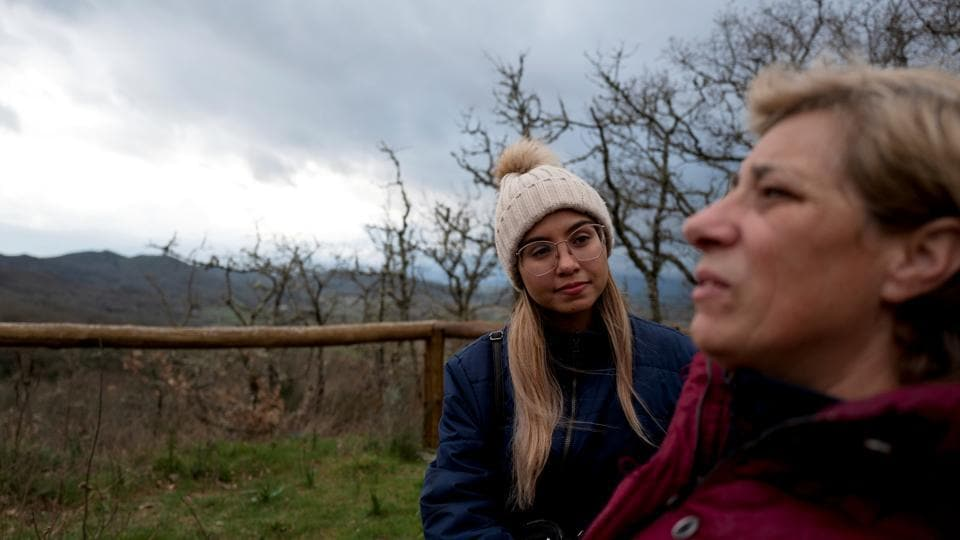 Arelis Morales, 30, and her husband Jose's aunt talk at the Monasterio de Trandeiras, Xinzo de Limia, Spain. Until January, Jose Martinez and his wife Arelis Morales were in the eye of Venezuela's political storm: he worked for an opposition leader, she advised human rights groups. (Ana Maria Arevalo Gosen / REUTERS)