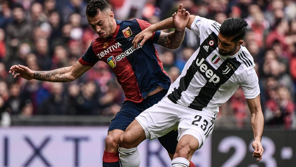 Genoa's Portuguese defender Pedro Pereira (L) and Juventus' German midfielder Emre Can vie for the ball in their Serie A match.
