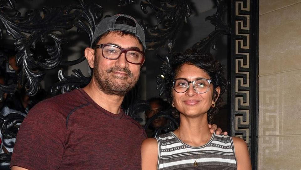 Aamir Khan along with his wife, film director and screenwriter Kiran Rao Khan, pose for photographs on his 54th birthday at his residence in Mumbai on March 14, 2019.