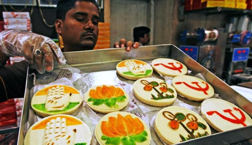 A shopkeeper displays his sweets with different political party symbol ahead of upcoming Lok Sabha poll in Kolkata.