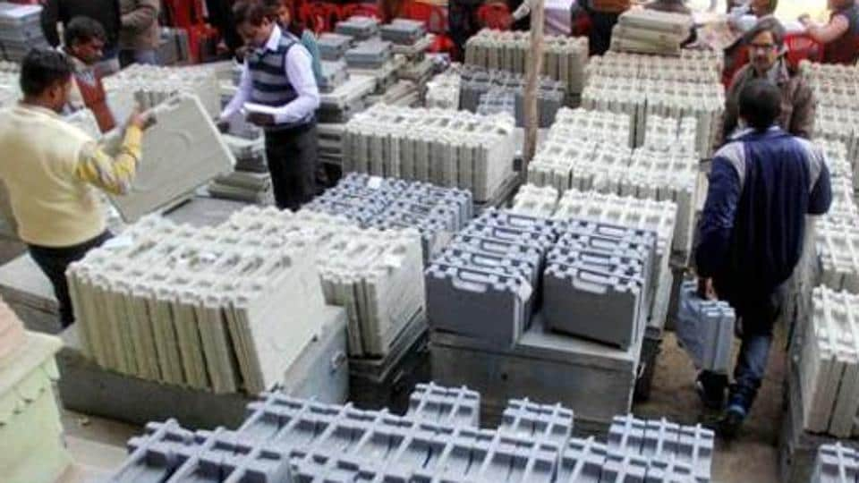 Polling officers collect electronic voting machines(EVM) and polling material before an election.