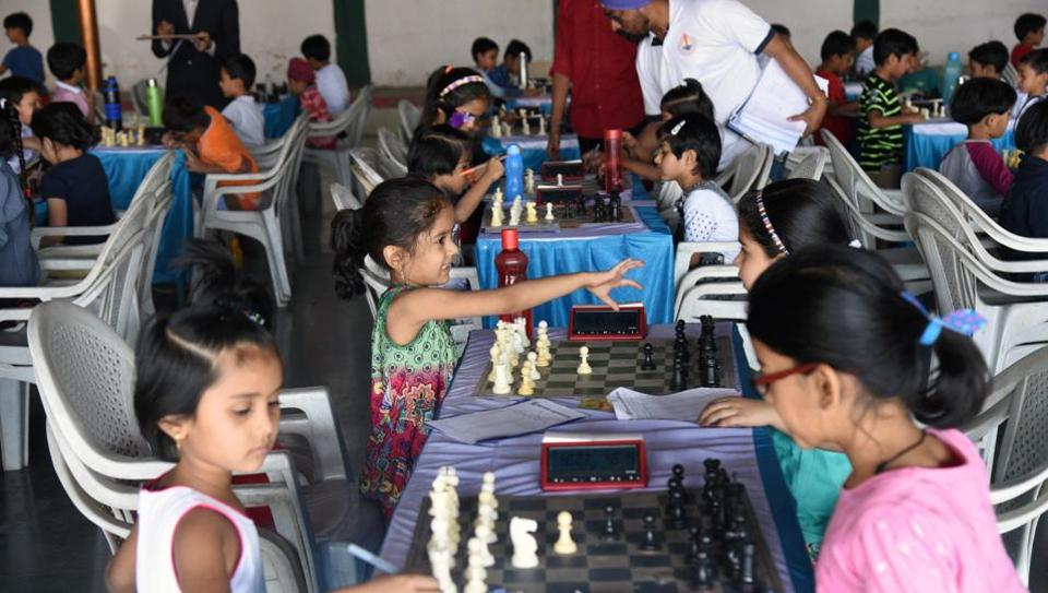 Participants belonging to under-7 age category in action on the first day of late Shikshanmaharshi Shivajirao Konde Memorial Maharashtra state selection under-7 chess championship played at Khed Shivapur. (Pratham Gokhale/HT Photo)