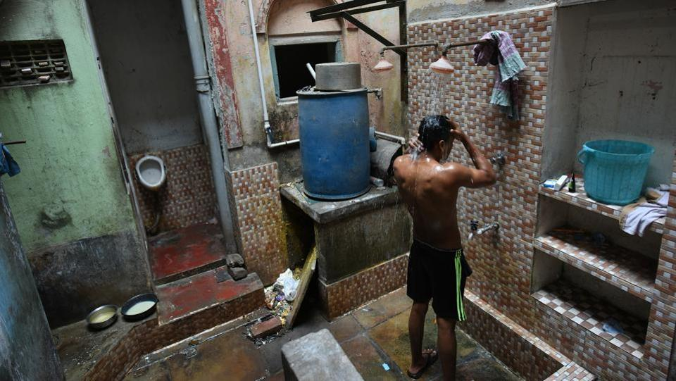 "Bathing at Raghunath Residency. ""The Messbari Project is a wonderful initiative and I will help take it forward in my capacity,"" said Bhattacharjee. Realising that there were many stories to be told, HWC launched an internship project to study messbaris. Armed with literary references, anecdotes and street directories dating back to 1915, interns began cataloguing the structures, and uncovering historical references. (Arijit Sen / HT Photo)"