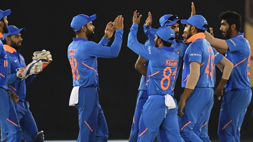 India cricketers celebrate the wicket of Australia cricketer Usman Khawaja.