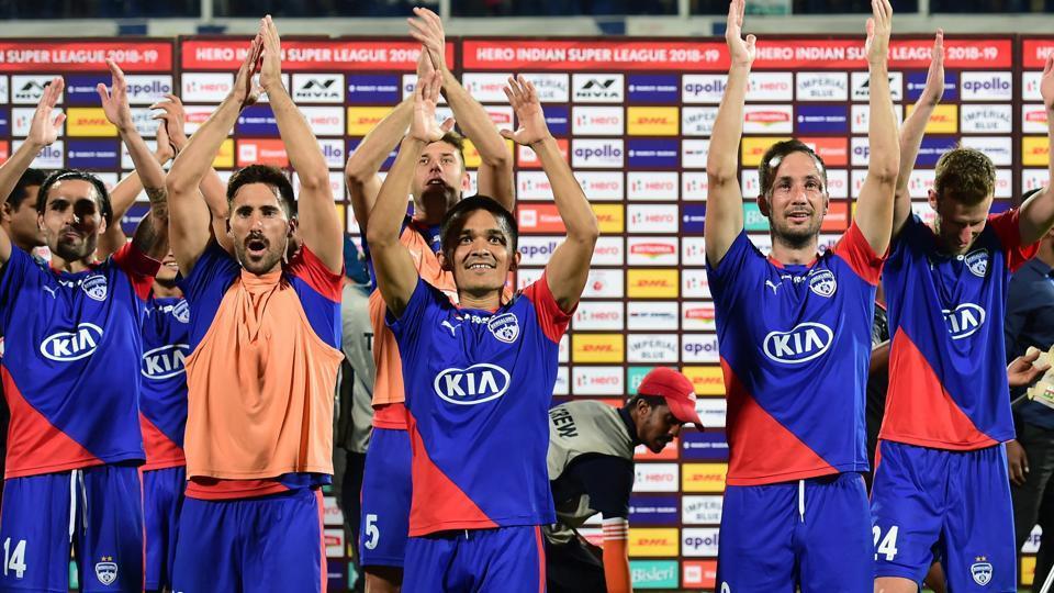 Sunil Chhetri and teammates celebrate after winning against North East United FC.