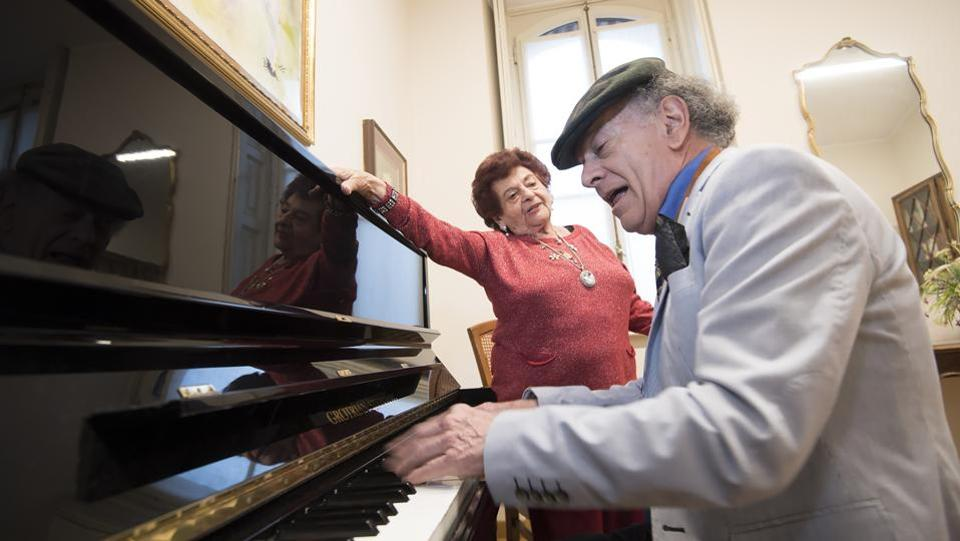 "Romanian musicologist Bissy Roman (L) and Italian pianist Raimondo Campisi at Casa Verdi. ""There came a time when I felt like I was all alone in the world, I didn't have anyone anymore, and the Casa Verdi was the last solution: dying with music in my heart and near my musician companions,"" she said. (AFP)"